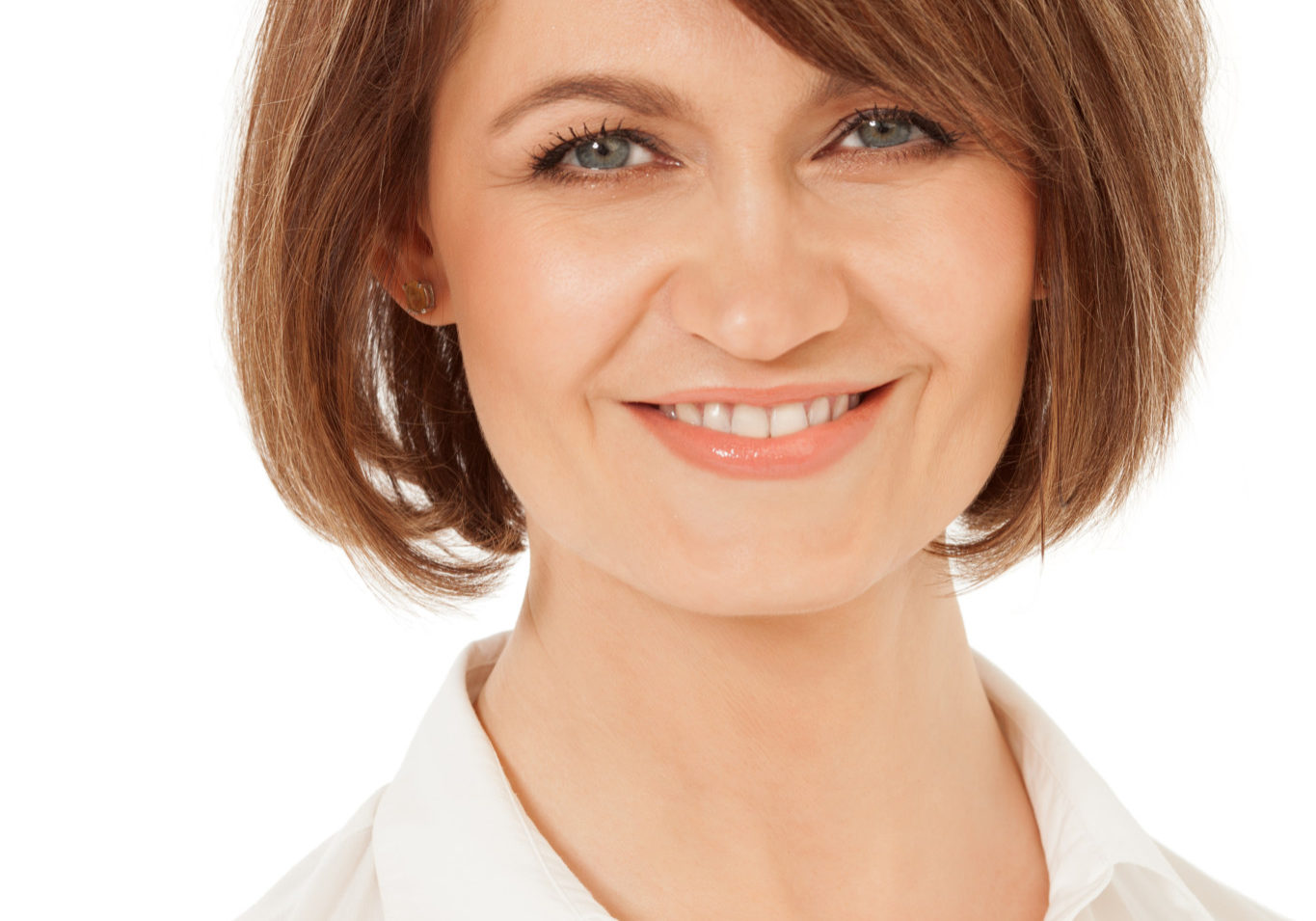 Close-up of smiling adult woman with short hair against of white background. Isolated.